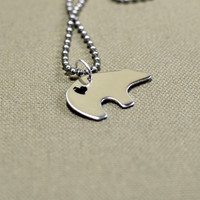 Sterling silver spirit bear pendant with heart cut out
