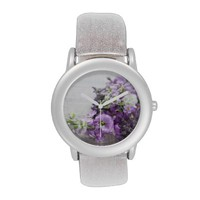lavender-colored flowers on old music watch