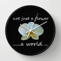 NOT JUST A FLOWER Wall Clock by catspaws