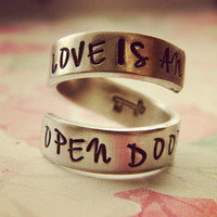 Live is an open door aluminum swirl ring skeleton key inside