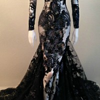 The Fenty Baudelaire Parker She Wore Black Fancy, Sequins, Tinsel, Micro Fiber Embroidery Gown on mesh/net. Pattern Embroidery on hem of gown and sleeves