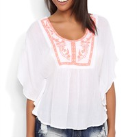 Flowy Peasant Top with an Embroidered Neck and Ladder Back