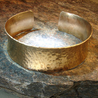 Formed copper anticlastic cuff bracelet with hammered texture