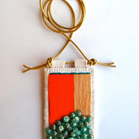 Colorblock embroidered pendant in orange tan teal and transparent teal glass beads on gold leather cord for Spring