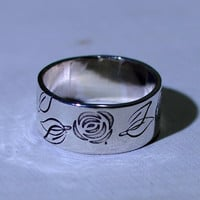 Sterling silver rose ring with flower power