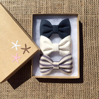 Textured blue, navy pinstripe, and winter white hair bows from seaside sparrow. The perfect gift for birthdays or any occasion.
