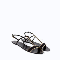 FLAT SANDALS WITH METALLIC EDGING