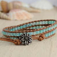 Hippie style light blue and brown bracelet. Sky blue beaded bracelet.