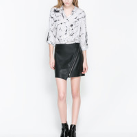 FAUX LEATHER MINI SKIRT WITH A ZIP