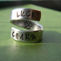 Lucky charm clover leaf inside aluminum swirl ring skeleton key inside