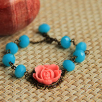 Bracelet: Pink colored rose cabochon with faceted blue glass beads, antique brass chain, perfect gift for her, mother's day gift