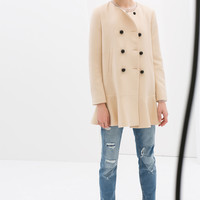 COAT WITH ROUND NECK AND FRILLY HEM