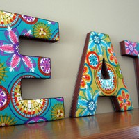 Decorative wall art spelling EAT in Carnival by kidsloveletters