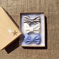 Blue and white striped, light blue shirting, and winter white hair bows from seaside sparrow.