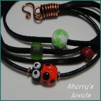 Ladybug and Lucky 4-Leaf Clover Lampwork Bead on Leather Bracelet | SherrysJewels - Jewelry on ArtFire