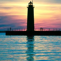 A Setting Sun Silhouettes the Muskegon Lighthouse | JohnHarmonGallery - Photography on ArtFire