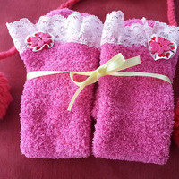 Long socks with stretchy lace trim and pink cotton flower with a button.