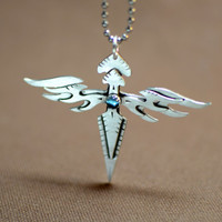 Sterling silver double wing cross with blue topaz