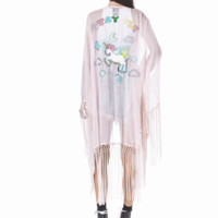Put together a chic look in the Stay Fly Kimono by Unif Clothing. This awesome knee length kimono features semi-sheer chiffon fabrication, quarter-length kimono sleeves with fringe detailing and embroidered stay fly unicorn cutout detailing on front and ba