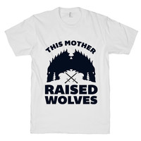 This Mother Raised Three Wolves on a White T Shirt