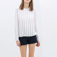 BLOUSE WITH RUFFLES ON THE FRONT