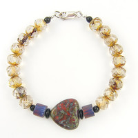 Boho Glass Bead Bracelet with Red Chunky Focal Bead, Blue Trade Beads and Brown Faceted Glass Beads