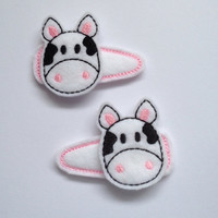 Cute Cow Felt Snap Clip Barrette in White Pink and Black. This is a set of 2 for $6.00.