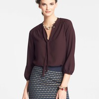 Quilted Yoke Tie Neck Blouse