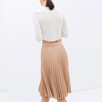 COATED PLEATED SKIRT