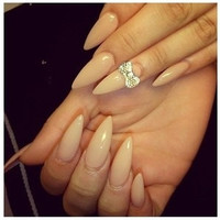 Nude stiletto square nails with diamanté bow