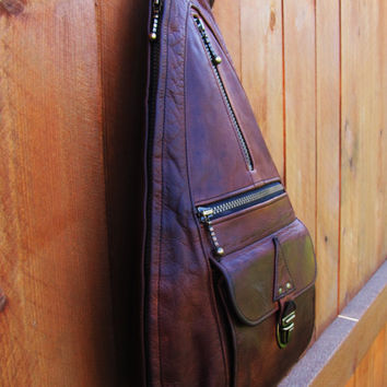 vintage whiskey brown leather sling / backpack.Ouellet. patina, color variation beautifully distressed.