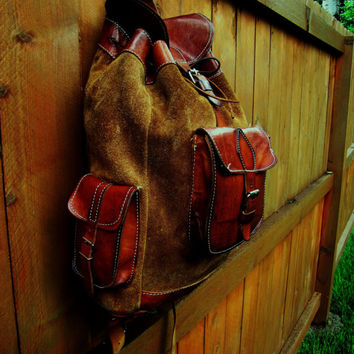 large distressed suede and leather western style rucksak. large distressed leather backpack. hipster backpack