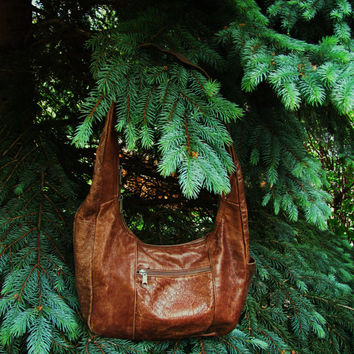 distressed brown leather hobo shoulder bag. sold as is. distressed leather hippie bag. made in Mexico