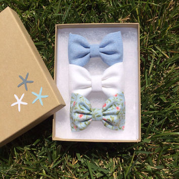 Blue chambray, white denim, and pale blue floral hair bows from Seaside Sparrow.  Seaside Sparrow bows make the perfect birthday gift.