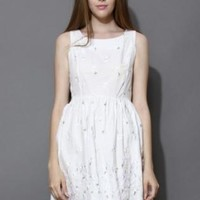 White dress with embroidered daisies