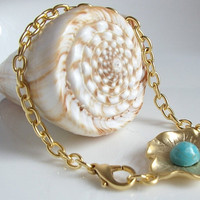 Gold plated flower charm with turquoise bracelet by BoreasDesign