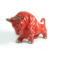 Ready to charge  ceramic red bull figurine by reconstitutions