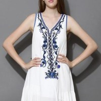 White dress with beaded embroidery