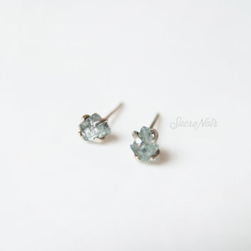 Petite claw sterling silver earring posts set with rough aquamarine gemstone