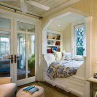 Bed in window nook.