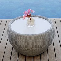 Modern Round Outdoor Wicker Side Table at HomeInfatuation.com.
