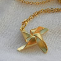 14 K gold plated matt Pinwheel necklace by LindaMunequita on Etsy