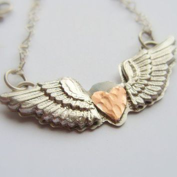 $60.00 Winged Heart sterling silver necklace Metalwork by Olympias