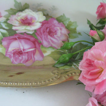 a gilded porcelain platter of roses ~ too too frou frou