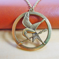 golden Hunger Games Logo Inspired by jewelrybraceletcuff on Etsy