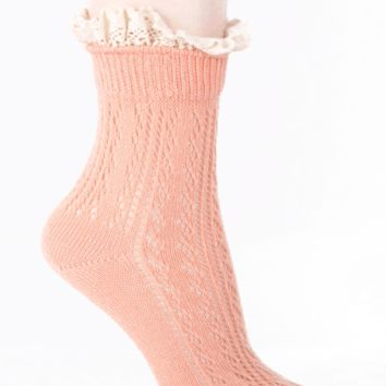 A pair of ribbed socks featuring a lacy trim. Pair with cutout oxford or flat.