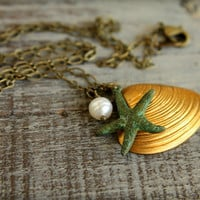 Brass Seashell &amp; Verdigris Starfish Necklace by saffronandsaege