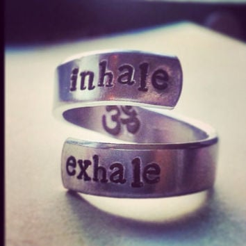Inhale exhale ring om symbol inside