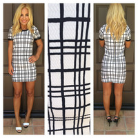 Off The Grid Plaid Midi Dress