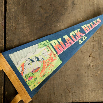 Vintage Black Hills of South Dakota Pennant. Mount Rushmore multi color on blue background. Souvenir
